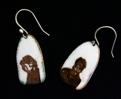 Earrings with face images from photo booth pictures enameled on to them